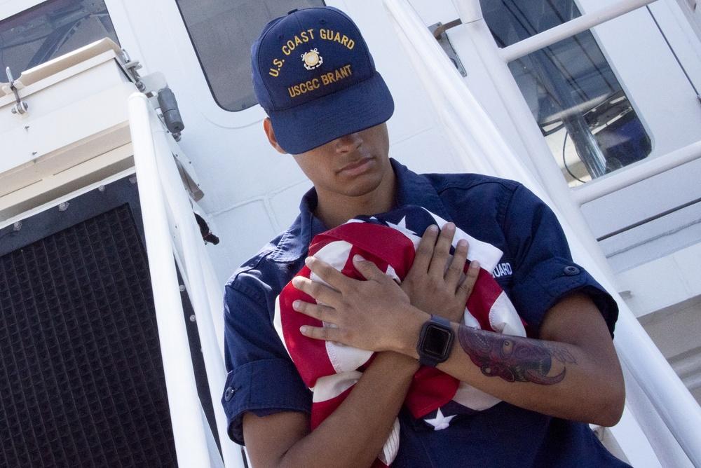 USCGC Brant Crew Member Posts National Ensign