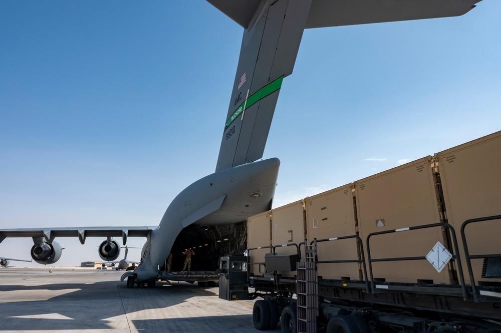 U.S. Air Force Airmen Prepare to Load Cargo