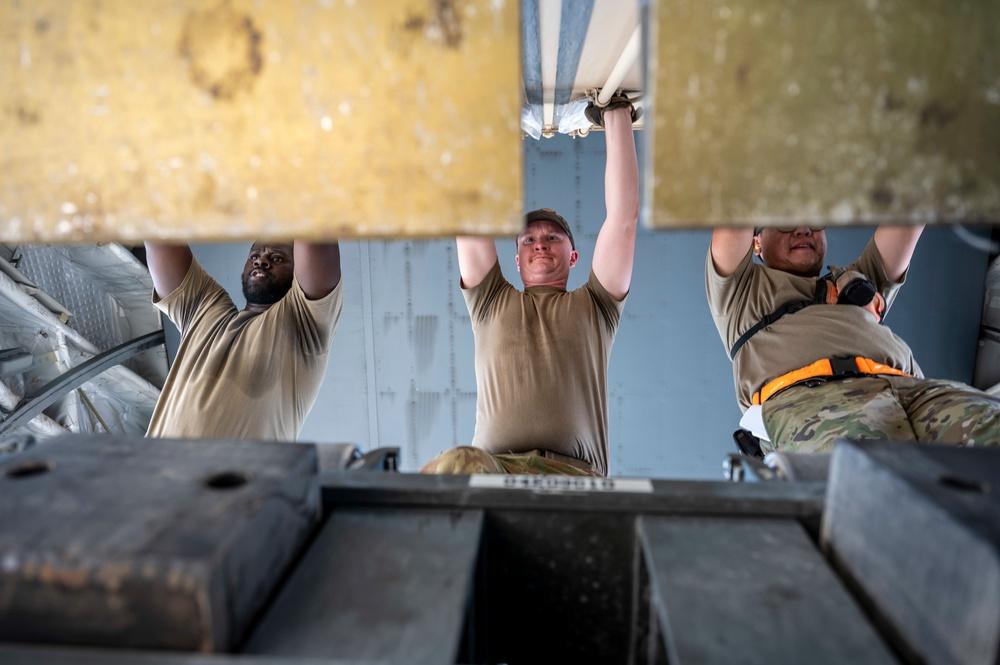 U.S. Air Force Airmen Load Cargo