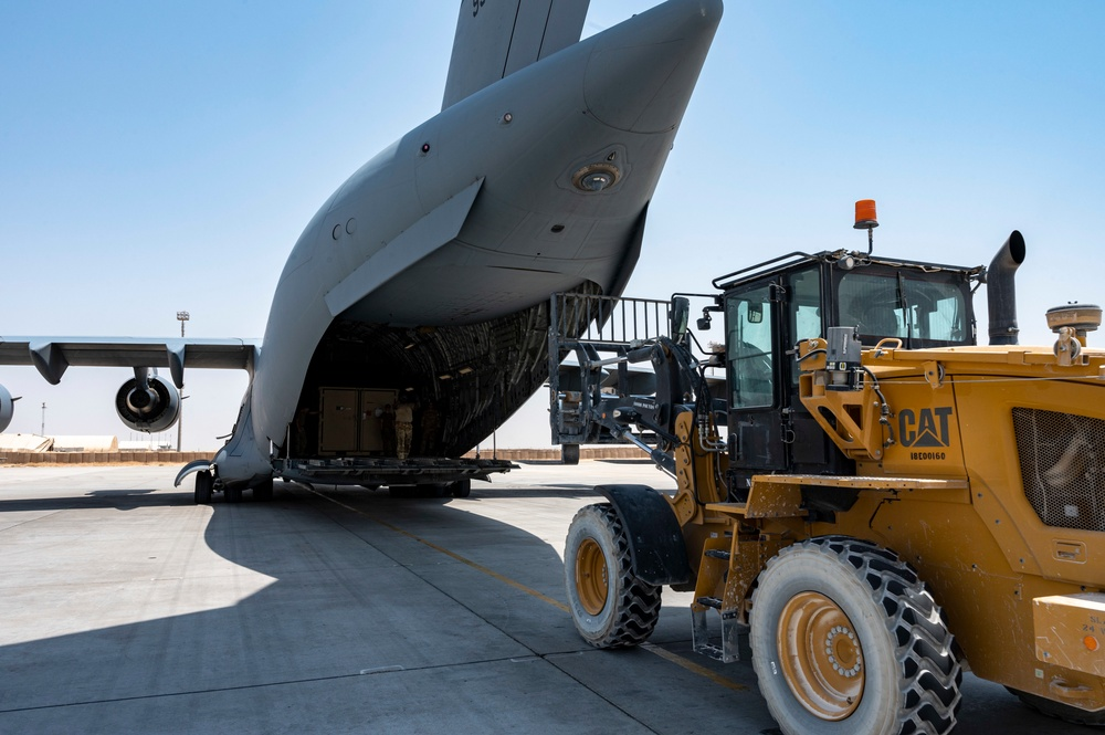 U.S. Air Force Airmen Prepare to Unload Cargo