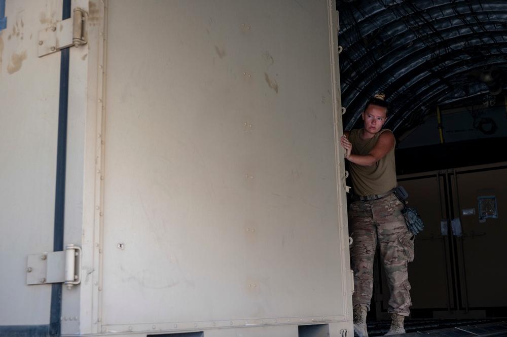 U.S. Air Force Airman Unloads Cargo
