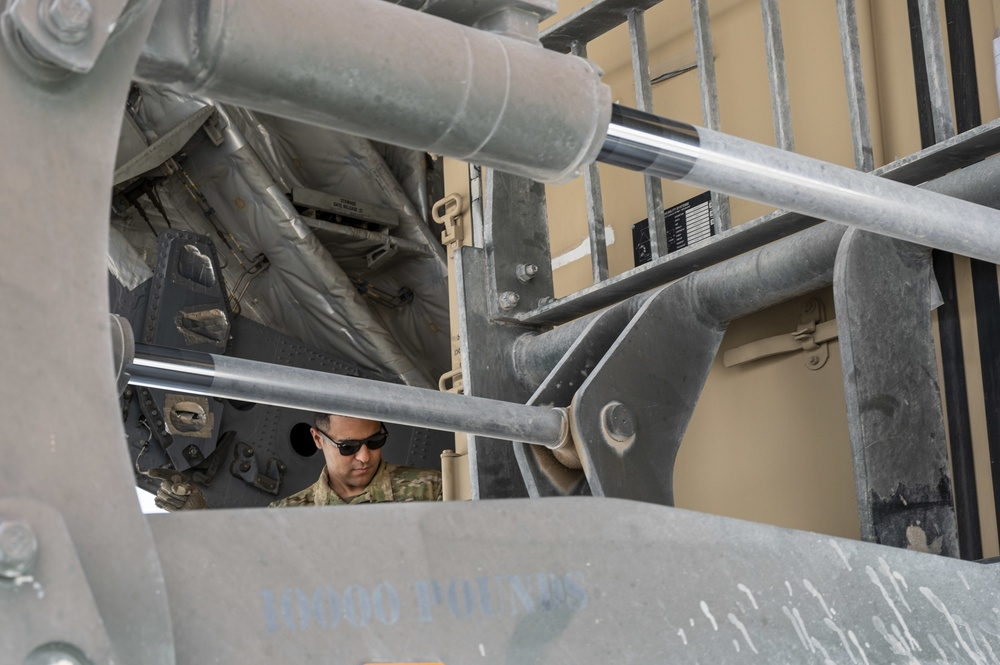U.S. Air Force Loadmaster Helps Unload Cargo