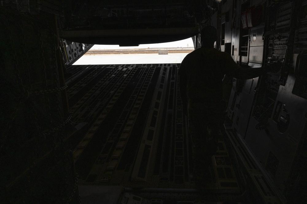 U.S. Air Force Loadmaster Closes Cargo Bay Door