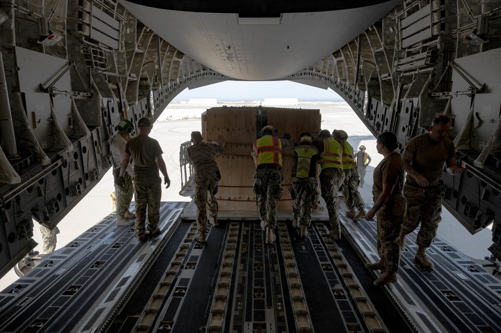 U.S. Military Members Help Unload Cargo