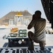 U.S., host nation Air Force members load cargo onto a Kuwait C-17 Globemaster III