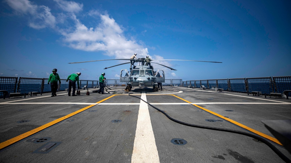 HSC 28 Sailors Refuel an MH-60S Seahawk Helicopter