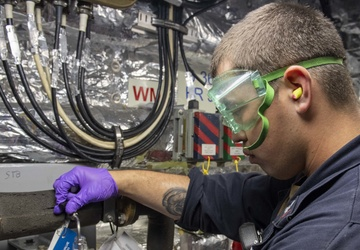 USS Jackson (LCS 6) Sailor performs potable water test