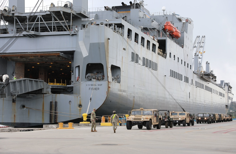 Soldiers Load Military Vehicles Onto U.S. Ship to Head Home