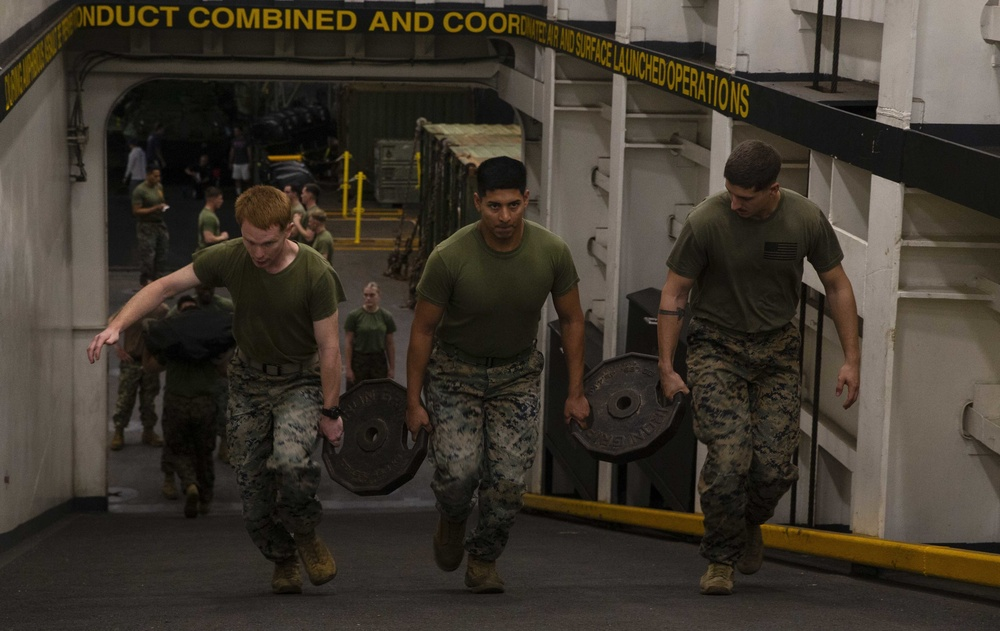 U.S. Marines with the 31st MEU conduct Squad PT during Corporals Course