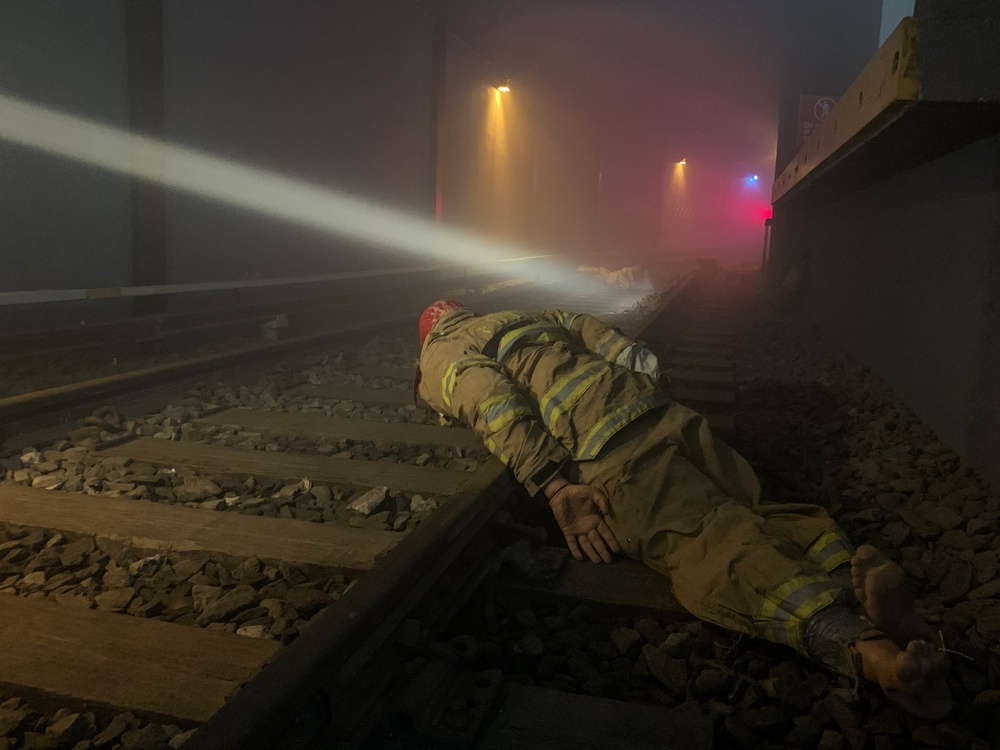 Search and Rescue teams train inside a subway simulator to extract notional victims