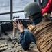 A Sailor loads an M240B light machine gun