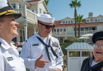 Sailors talk with WW2 Veteran