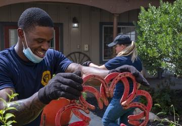 Sailors participate in a community outreach in Wilmington, Del.
