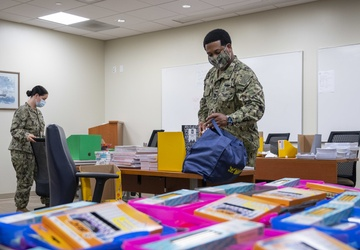 Sailors build kits for a back to school supplies drive