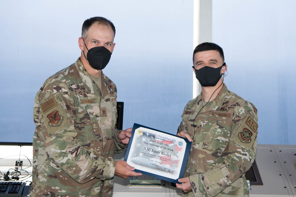 436th Airlift Wing leadership recognizes this week's Top Performer