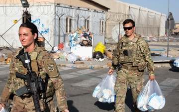 Soldiers Move Packaged Care Bags to Deliver to Evacuating Families [Image 5 of 5]