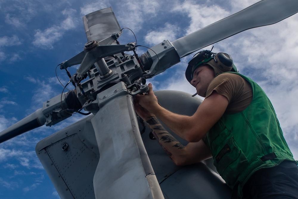 Sailor Conduct Maintenance on an MH-60R Seahawk Aboard USS Michael Murphy (DDG 112)