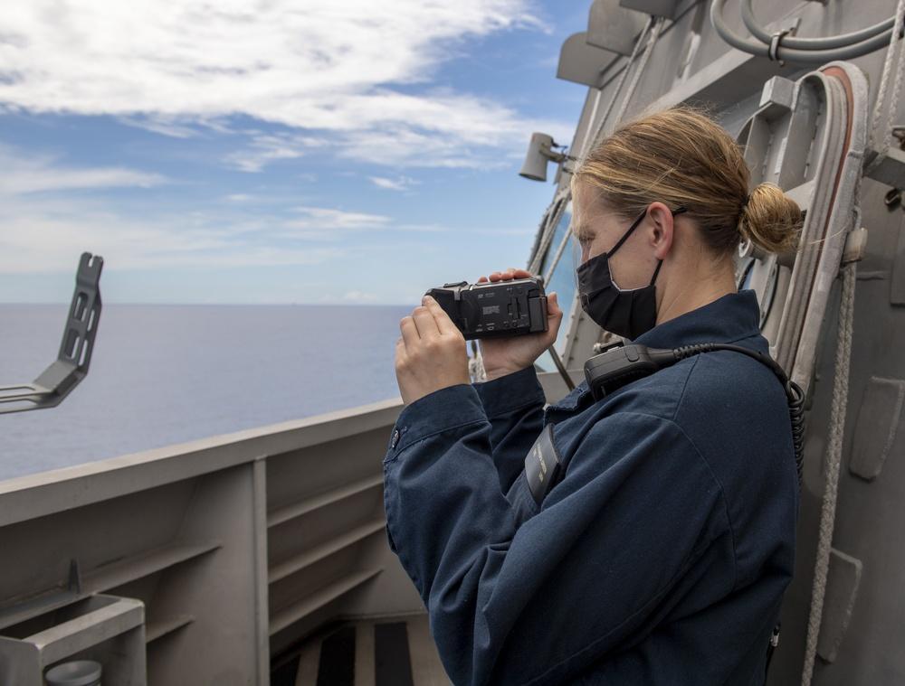 USS Jackson (LCS 6) Sailor stands watch on bridge wing