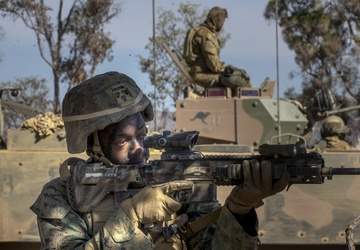Marines and Australian conduct a mechanized infantry assault for Exercise Koolendong