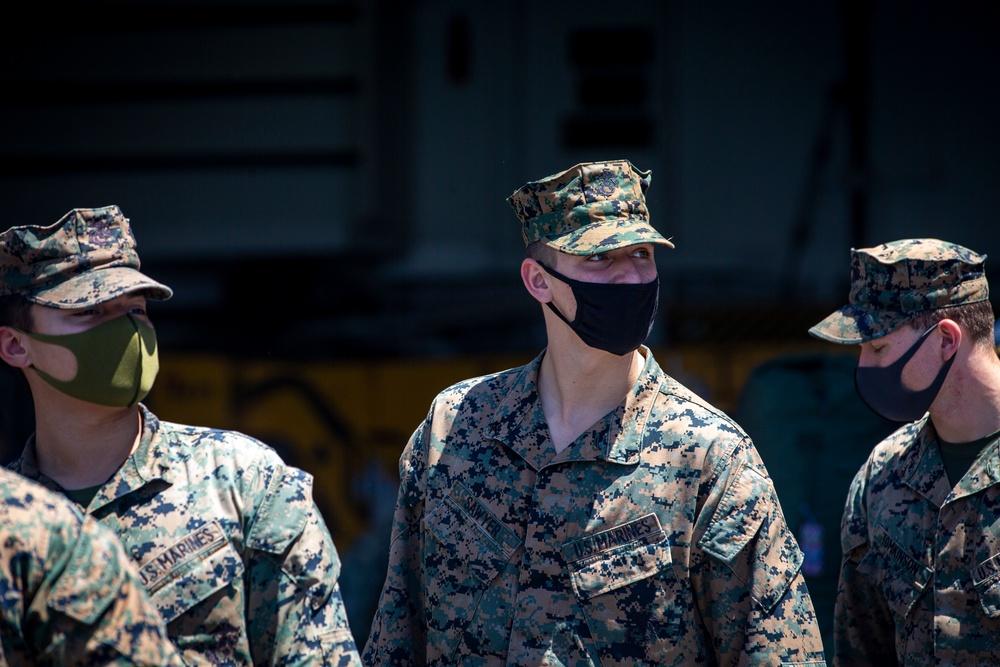 US Marines and Sailors debark USS America