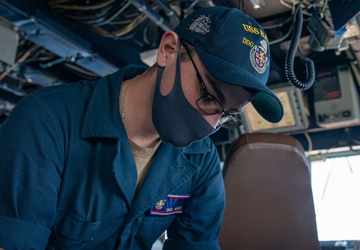QMSN Dade Geier Prepares a Position Report in the Pilot House aboard the USS Barry