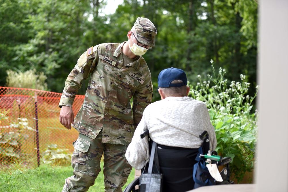 Michigan National Guard members work with veterans at the Michigan Veteran Homes at Grand Rapids