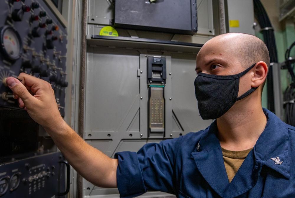 ET3 Cesar Chavez conducts a Maintenance Check aboard the USS Barry