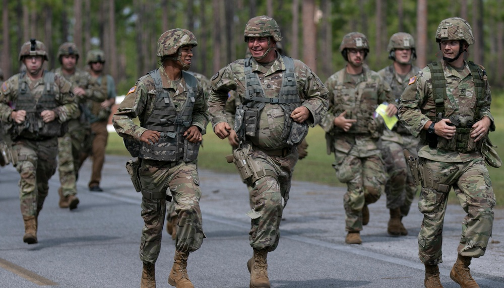 Soldiers run to their firing lanes during a pistol firing event at the Florida National Guard's annual TAG Match