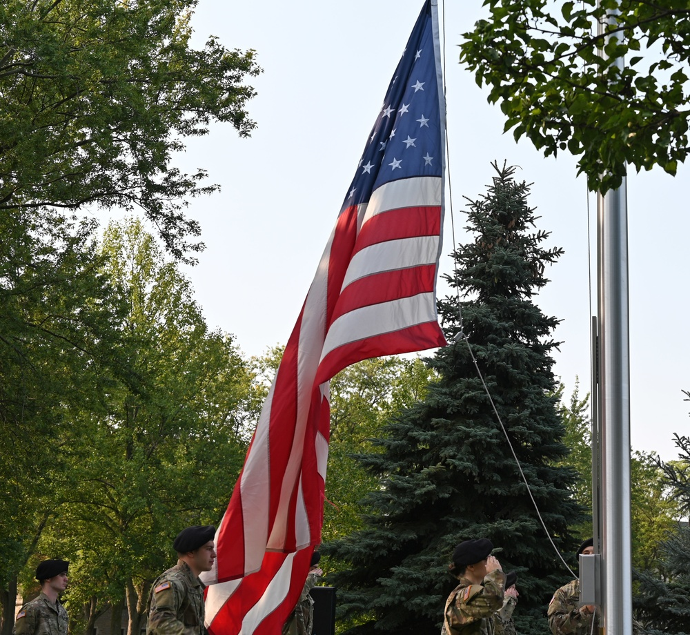 Troops salute flag during 9/11 ceremony