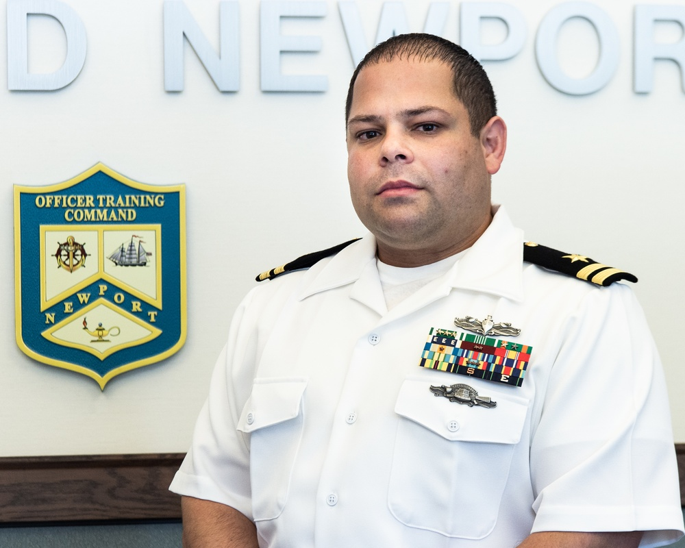 210914-N-TE695-0008 NEWPORT, R.I. (Sept. 14, 2021) Lt. Roberto Duarte provides administrative support to the critical military and civilian staff members who develop and deliver warfighters to the fleet