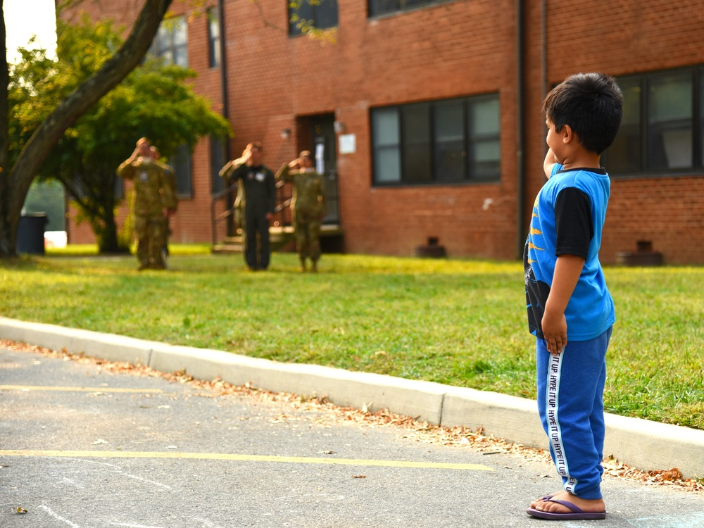 Afghan child salutes during U.S. national anthem