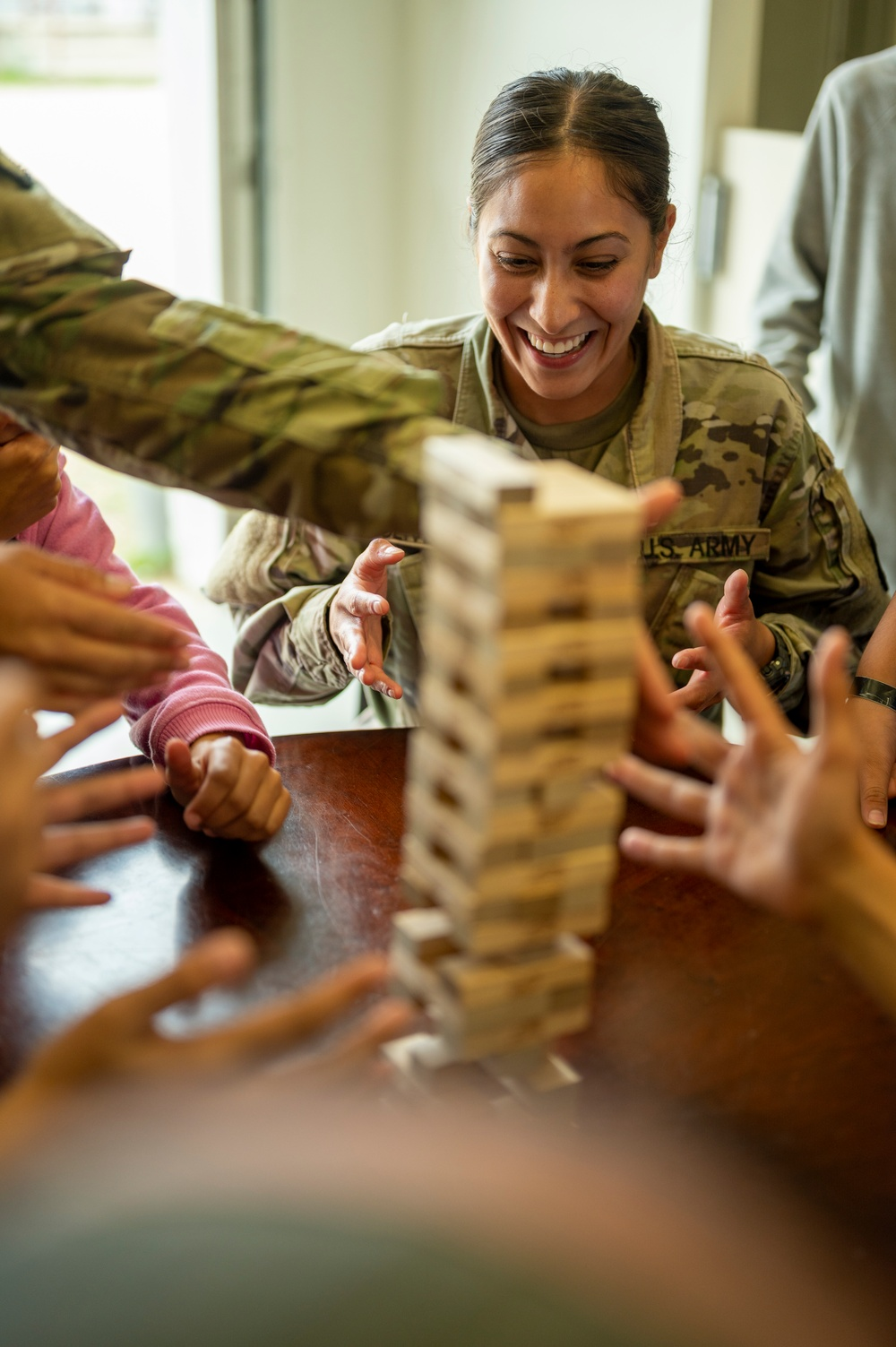 Task Force McCoy Soldiers play games with guests
