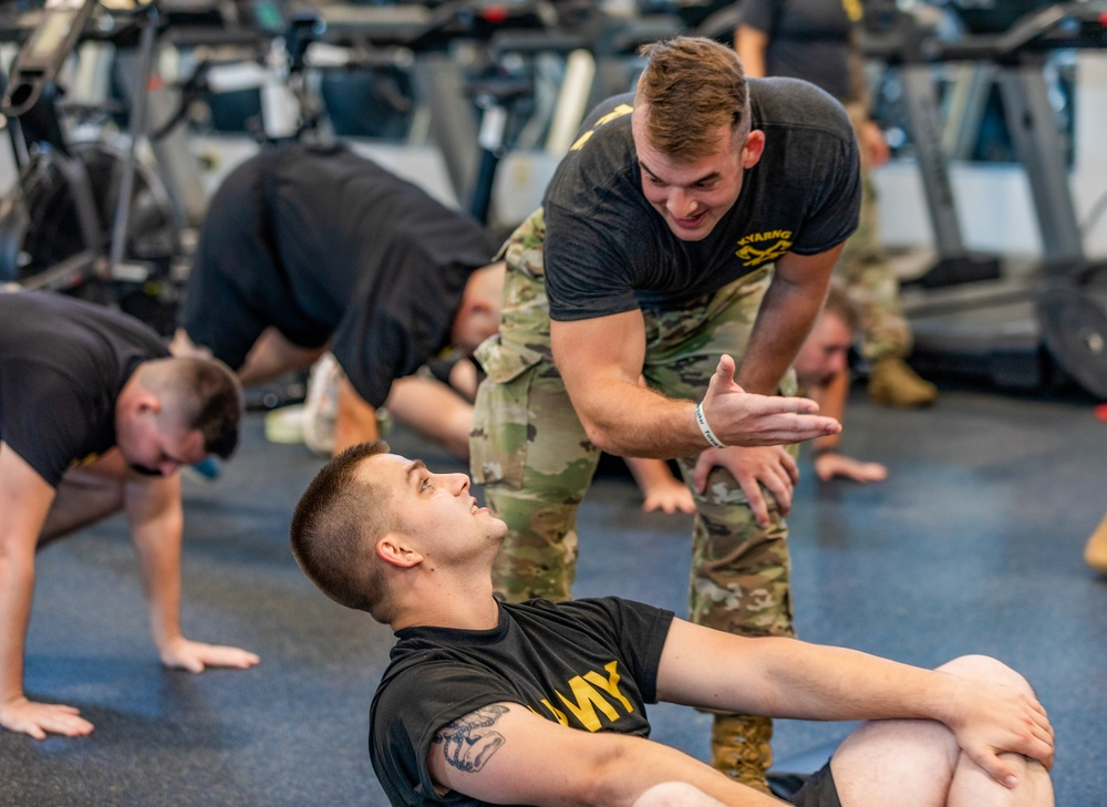 Spc. Kory Waller with Headquarters and Headquarters Battalion, 2nd Battalion, 138th Field Artillery Brigade instructs and encourages Soldier as he completes an exercise as part of a team exercise event at Boone National Guard Center on Sept. 7th, 2021.