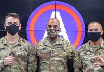 Lt. Gen. Ronald Clark presents Coins to Spc. Huth and Staff Sgt. Thao