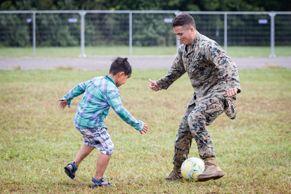 U.S. Marine Plays Soccer with an Afghan Child