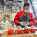 USS Charleston Sailor conducts jacket water concentration test
