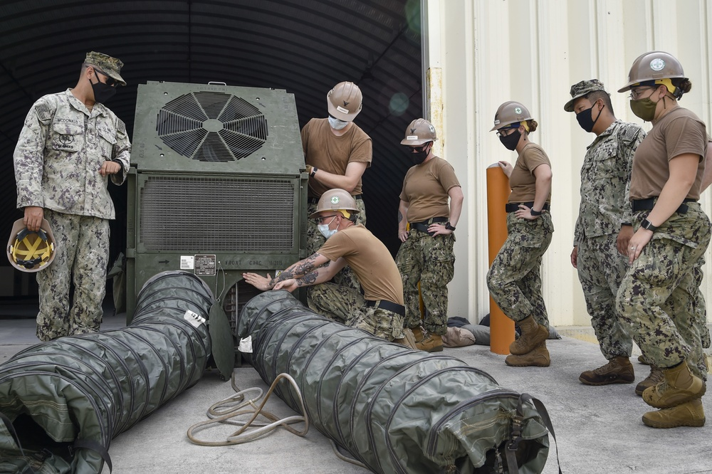 US Navy Seabees assigned to Naval Mobile Construction Battalion 5 set up an environmental control unit