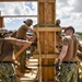 US Navy Seabees assigned to Naval Mobile Construction Battalion 5 build framework to support III Marine Expeditionary Force and 9th Engineer Support Battalion