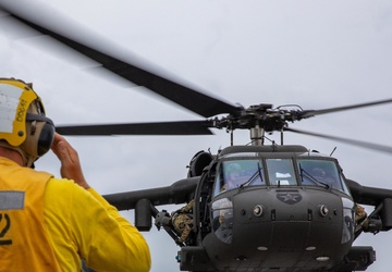 A U.S. Army UH-60 Black Hawk Conducts a Deck Landing Qualification on the Flight Deck with USS Barry