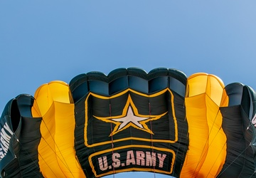 U.S. Army Parachute Team jumps on the U.S.S. Midway