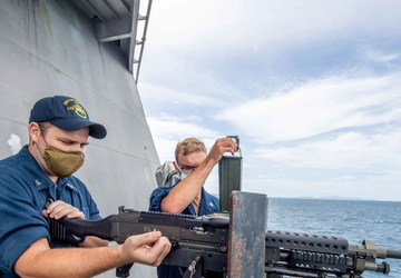 USS Charleston Sailors Mount a M240B Machine Gun