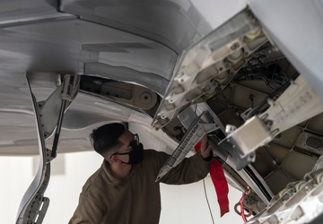 525th Aircraft Maintenance Unit Airmen arm F-22 Raptors during the Weapons Load Crew of the Quarter competition