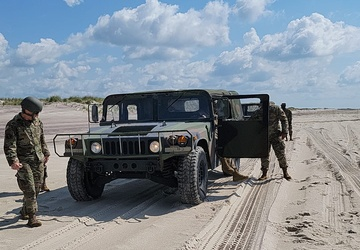 Hitting the beach : 106th Rescue Wing trains for winter driving in summer beach sands.